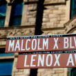 New York Malcom X Blbd Lenox Avenue street sign in Harlem — Stock Photo