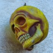 A yellow paper skull on aluminum foil — Stock Photo