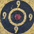 Vintage heavly used bull's eye darts target — Stock Photo #22876272