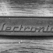 Vintage electronics metal plaque in black and white — Stock Photo #22876318