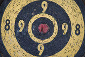 Vintage heavly used bull's eye darts target — Stock Photo