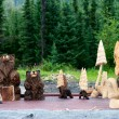 Royalty-Free Stock Photo: Wood Carved bears and trees in Cooper Landing Alaska