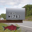 Red Salmon Mailbox on a road in Kenai peninsula, Alaska — Stockfoto