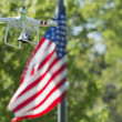A security drone on stars and stripes USA flag — Stock Photo