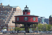 Flat red Lightghouse in Baltimore Maryland Harbor — Stock Photo