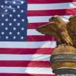 Usa Eagle bronze statue on American flag stars and stripes background — Stock Photo