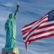 Usa American flag stars and stripes on statue of liberty blue sky background — Stock Photo #25302119
