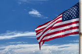 Usa American flag stars and stripes on the blue sky background — Stock Photo