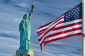 Usa American flag stars and stripes on statue of liberty blue sky background — Stock Photo