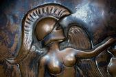 Old bronze greek bas relief — Stock Photo