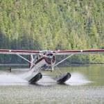 A Floatplane while landing on Alaskan lake — Stock Photo #26024957