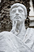 Marble roman statue the tinker — Stock Photo