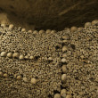 Paris Catacombs Skulls and bones — Stock Photo #26602519