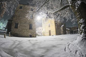 Night view of a church while snowing — Foto Stock
