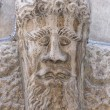 Stock Photo: Medieval bas relief head statue