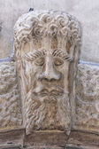 Medieval bas relief head statue — Stock Photo