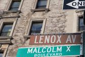 New York Malcom X Boulevard Lenox Avenue street sign — Foto de Stock