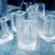 Ice blocks glasses in a ice hotel bar pub — Stock Photo