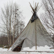 Teepee in the snow background — Stock Photo