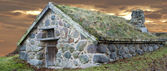 Stone cabin with grass roof — Stock Photo
