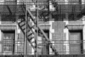 Old Building fire ladder in black and white — Stockfoto