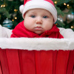 Baby boy in Santa hat in the red basket — Stock Photo #41091141