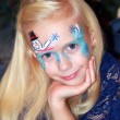 Little girl with Christmas face painting — Stock Photo #41091165