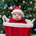 Baby boy in Santa hat in the red basket — Stock Photo
