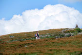 Father and daughter walking at mountain meadow — Stock Photo
