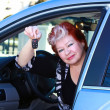 Middle age women sitting in the car — Stock Photo