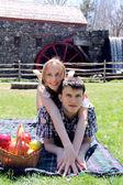 Couple having a picnic outdoor — Stock Photo