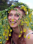 Young girl in flowers wreath — Stock Photo