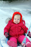 Toddler girl in the sledge — Stock Photo