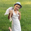 Girl with angel wings shows thumbs up — Stock Photo