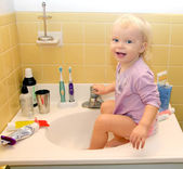 Toddler sitting in the wash-bowl — Stock Photo