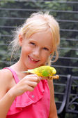 Little girl with the parakeet — Stock Photo