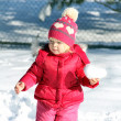 Cute girl in winter park — Stock Photo #42448941