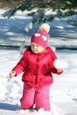 Cute girl in winter park — Stock Photo