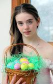 Teenage girl with Easter basket — Stock Photo