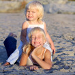 Little girls having fun on the beach — Stock Photo