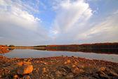 Sunset under the lake — Stock Photo