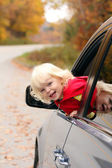 Girl looking out of the car — Stock Photo