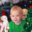 Happy toddler girl with a Christmas tree — ストック写真