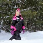Smiling little girl in the winter park — Stock Photo