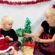 Two little girls with the Christmas gifts and boxes — Stock Photo