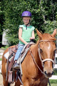 Cute little girl riding the horse — Foto Stock