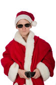 Young boy as Santa Claus with sunglasses — Stock Photo