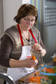 Pensioner at cooking course — Stock Photo