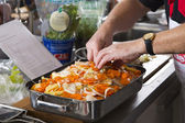 Cook prepares a casserole — Stock Photo