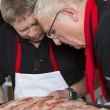 Stock Photo: Two cooks consider main course